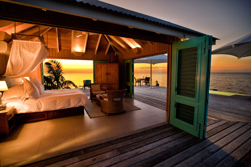 Take in the romantic sunset at your own private beachfront villa